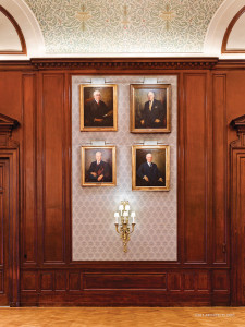 The presidential portraits are now located on upholstered panels of stretched damask, which provide a handsome backdrop for the portraits and improve the acoustics of the room.