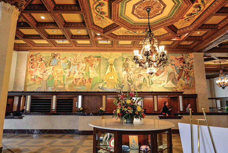 The 40-ft. mural behind the reception desk, completed in 1948 by Carl Roters, had been hidden behind mirrors. It was restored by Marek Mularski, art conservator with John Tiedemann Inc.