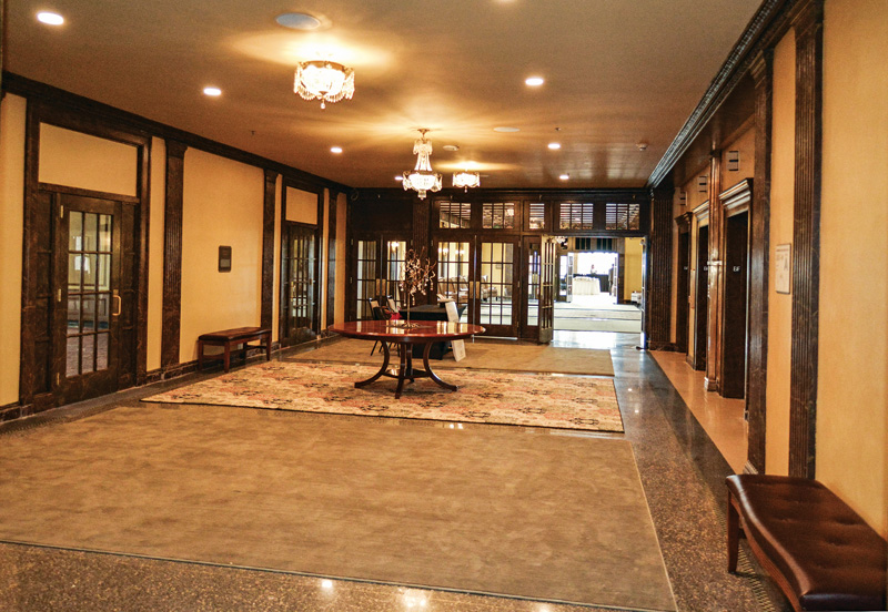 The faux finishes in the tenth-floor elevator lobby were restored and replicated.